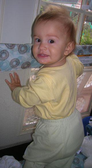 J standing in crib